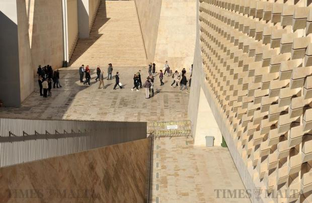 People stream through City Gate past Parliament House in Valletta on December 30. Photo: Chris Sant Fournier