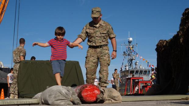 A soldier helps a child negotiate an obstacle course during the Armed Forces of Malta Open Day at the Valletta Waterfront on October 17. Photo: Steve Zammit Lupi