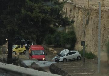 "A damaged car outside the tunnels in Sta Venera. Picture Alan Coppini - <a href=""mailto:mynews@timesofmalta.com"" target=""_blank"">mynews@timesofmalta.com</a>"
