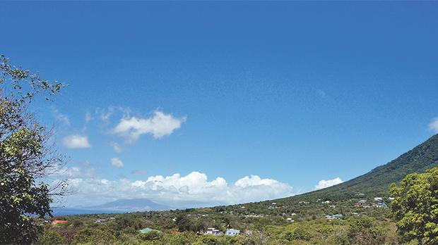 View of the Caribbean island of Nevis and the Nevis volcano peak as seen from the Montpelier Plantation in the Federation of St Kitts and Nevis.