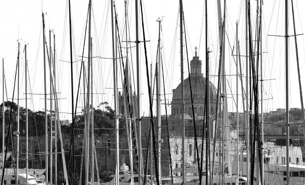 The Anglican cathedral and the Carmelite church in Valletta are seen through sailing boat masts at Ta'Xbiex on Januany 31. Photo: Chris Sant Fournier
