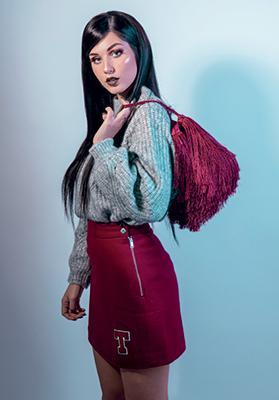 Grey high neck knit: Mango - €39.99. Wine wool skirt: Tommy Jeans - €99.90. Fringe bag: Mango - €39.99.