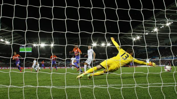 Manchester City's Alex Garcia Serrano scores their second goal. Photo: Andrew Boyers, Reuters