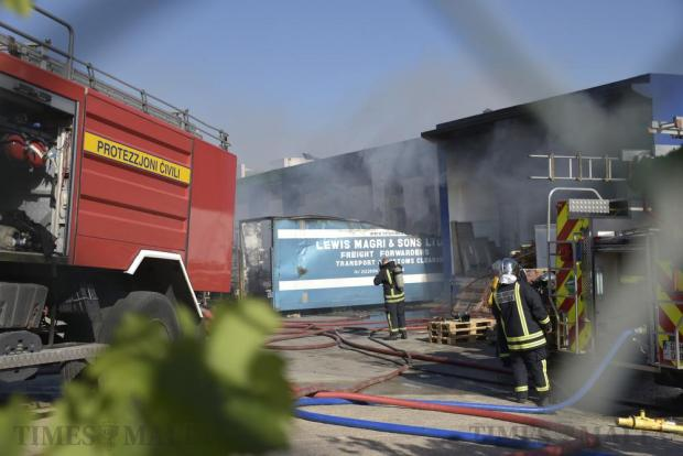 Firefighters tackle a fire that broke out in a factory in Bulebel on May 24, which produced a thick column of smoke seen from various parts of Malta. Nobody was injured in the blaze, which caused extensive damage across most of the factory. Photo: Mark Zammit Cordina