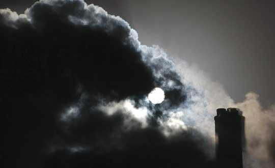 The sun is seen through the steam and other emissions coming from funnels of the brown coal Loy Yang Power Station in the Latrobe Valley near Melbourne, Australia.