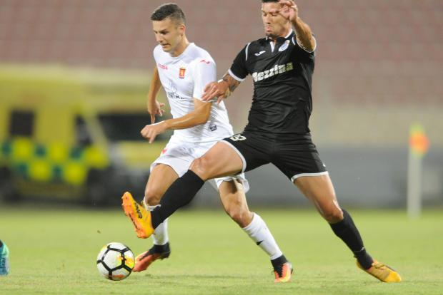 Valletta's Jean Borg (left) tussles for the ball with Johann Bezzina. Photo: Stephen Gatt
