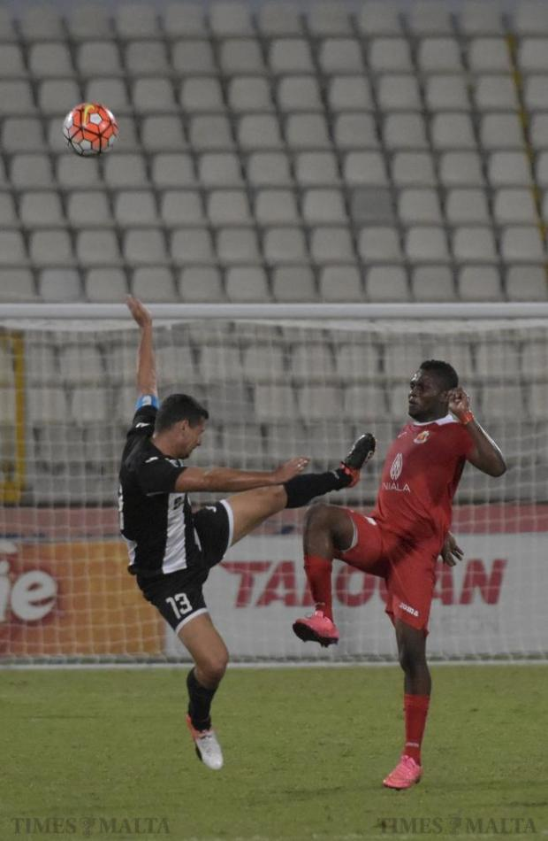 Hibernians' Clayton Failla tries to take the ball from Valletta's Umeh Uchenna during their Premier League football match at the National Stadium in Ta' Qali on September 25. Photo: Mark Zammit Cordina