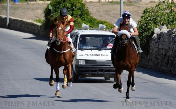 Two jockeys and their horses approach the finishing line during the traditional L-Imnarja horse street races held at Saqqajja hill, near Rabat on June 29. Photo: Steve Zammit Lupi