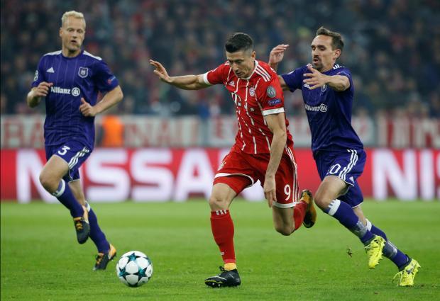 Bayern striker Robert Lewandowski (centre) charges forward against Anderlecht.