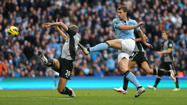 Manchester City's Edin Dzeko scores his side's second goal of the game during the Barclays Premier League match at the Etihad Stadium, Manchester. Photo: Dave Thompson, PA Wire