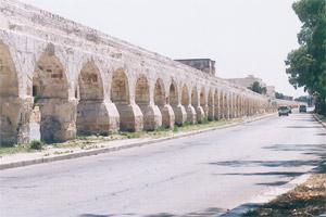 The Wignacourt Aqueduct, looking grand but missing the various colours of the profusely flowering oleander trees that grew against each arch.