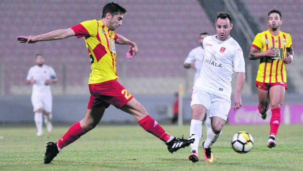 Valletta's Michael Mifsud (right) is challenged by Cain Attard, of Birkirkara.