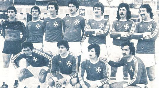 Malta before the match against West Germany on February 25, 1979. Standing (from left): C. Sciberras, J. Holland, G. Xuereb, N. Buttigieg, E. Spiteri Gonzi, D. Buckingham, E. Farrugia. Squatting: V. Magro, E. Farrugia, R. Xuereb, G. Xuereb.