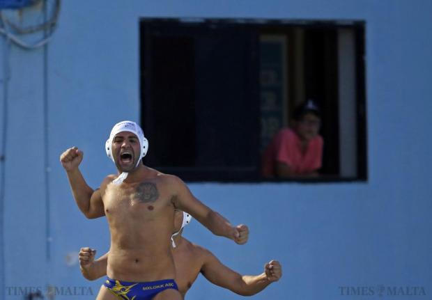 Marsaxlokk's Rainer Scerri celebrates a teammate's goal during their First Division waterpolo match against Marsascala at the National Pool in Tal'Qroqq on August 19. Photo: Darrin Zammit Lupi