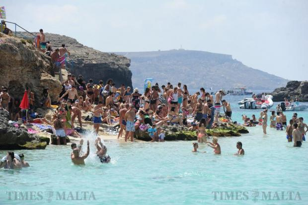 Bathers enjoy the summer sun and clear waters at Blue Lagoon, Comino on August 17. Photo: Steve Zammit Lupi