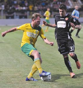 Paltemio Barbetti (left) defending possession from Gustavo Villalobos during a league match last season. Barbetti and Villalobos will be playing for Pembroke Athleta in the 2015-16 campaign.