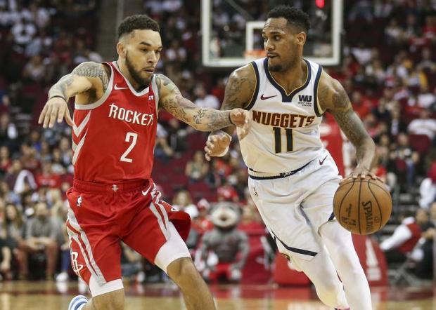 32d4b33a683 Denver Nuggets guard Monte Morris (11) dribbles the ball as Houston Rockets  guard Chris