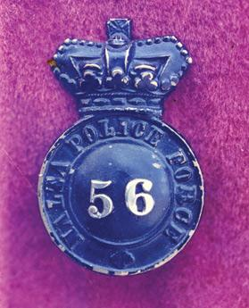 The first police cap badge.