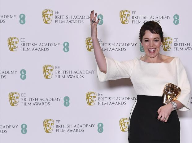 British actress Olivia Colman poses with the award for a Leading Actress for her work on the film 'The Favourite'.