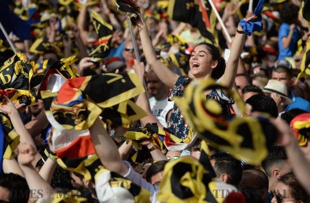 PN supporters cheer before Simon Busuttil takes to the stage at a mass meeting in Balzan on May 7. Photo: Matthew Mirabelli