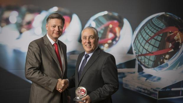 Angelo Sciberras, Air Malta's Manager France, Benelux & Switzerland (right) receives the award from Brussels Airport Company CEO, Arnaud Feist.