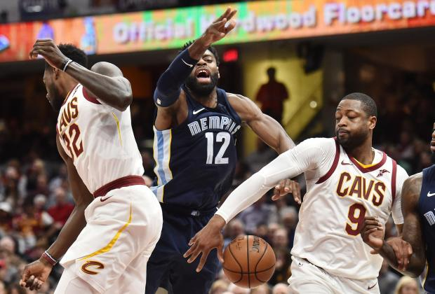 Cleveland Cavaliers guard Dwyane Wade (9) strips the ball from Memphis Grizzlies guard Tyreke Evans (12) during the first half at Quicken Loans Arena. Photo: Ken Blaze-USA TODAY Sports