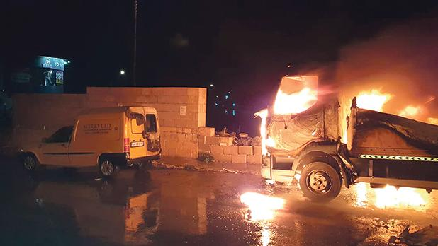 One ofFabrizioSciré'strucks on fire outside his stores last Saturday before the alleged beating took place.