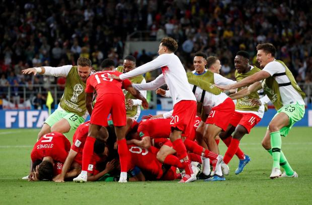 England's Eric Dier celebrate winning the penalty shootout with team mates.