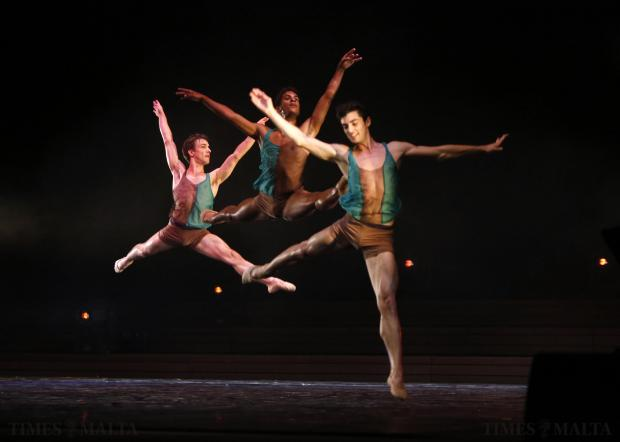 """(left to right) French dancer Pierre Tappon, Portuguese dancer Marcelino Sambe and Albanian dancer Alvaro Dule perform in """"Just Dance"""", choreographed by Antonia Franceschi of the U.S. and featuring dancers from The Royal Ballet, Rambert, Ballet Black and Random Dance, at Pjazza Teatru Rjal in Valletta on August 9. Photo: Darrin Zammit Lupi"""