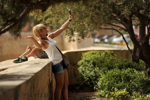 A tourist takes a selfie at the upper Barrakka Gardens in Valletta on April 26. Photo: Chris Sant Fournier