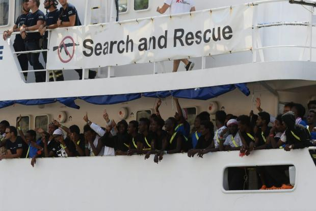 Rescued people cheer as they approach Malta. Photo: Jonathan Borg