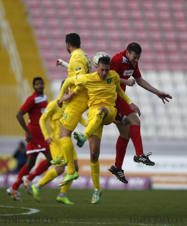 Balzan's Andrew Scicluna (right), Floriana's Conor Borg (centre) and No 19 (left) challenge for a high ball during their Premier League football match at the National Stadium in Ta' Qali on January 3. Photo: Darrin Zammit Lupi