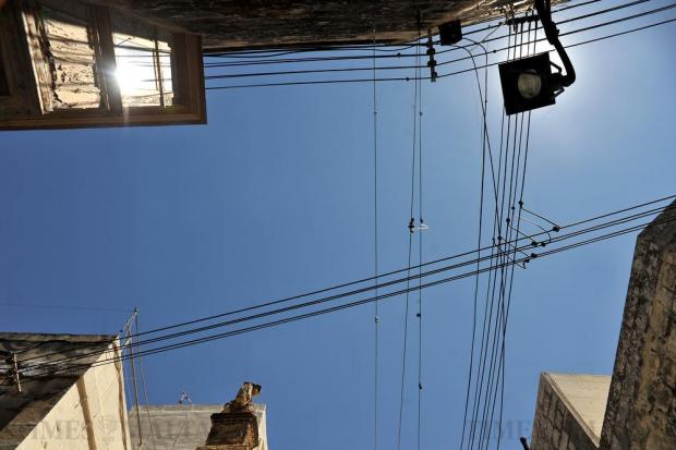 Wires hang across Saint Augustine Street in Rabat on July 20. Photo: Chris Sant Fournier