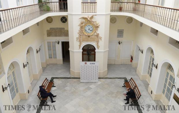 Two men wait in the foyer of the Chamber of Commerce in Valletta ahead of a meeting of the Turkey-Malta business forum on February 17. Photo: Matthew Mirabelli