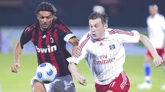 Paolo Maldini (left) in one of his last matches.