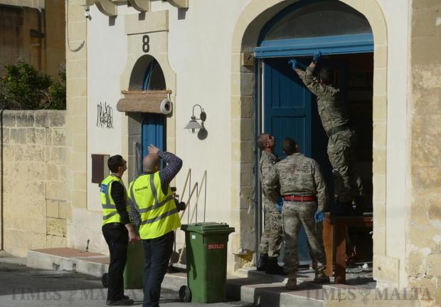 Members of the Armed Forces of Malta clear up debris after an explosive device went off at the residence of a businessman in Xaghra ,Gozo, on January 8. Photo: Matthew Mirabelli