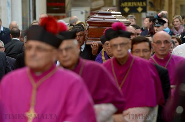 Members of the clergy participates in the cortege as the body of Archbishop Emeritus Joseph Mercieca is carried to St John's Co-Cathedral in Valletta on March 21. Photo: Matthew Mirabelli
