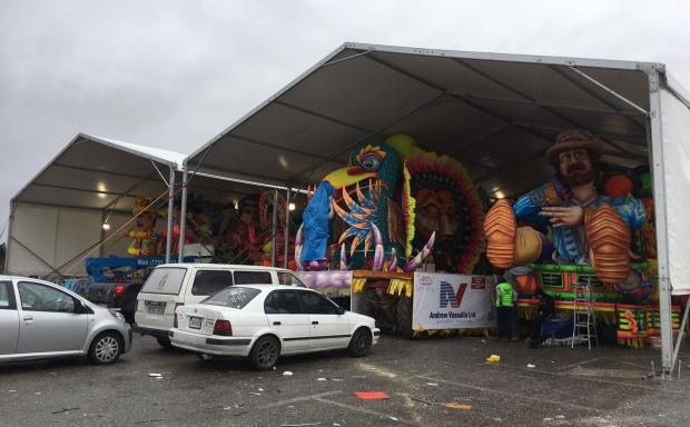 The carnival floats sheltered under a tent.