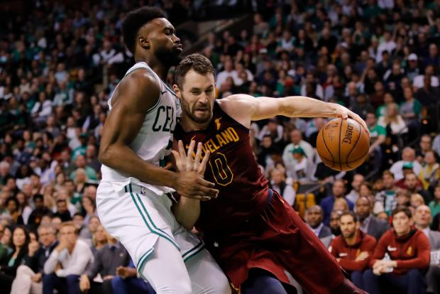 Cleveland Cavaliers center Kevin Love (0) drives against Boston Celtics guard Jaylen Brown (7) during the second quarter in game one of the Eastern conference finals of the 2018 NBA Playoffs at TD Garden. Photo Credit: David Butler II-USA TODAY Sports