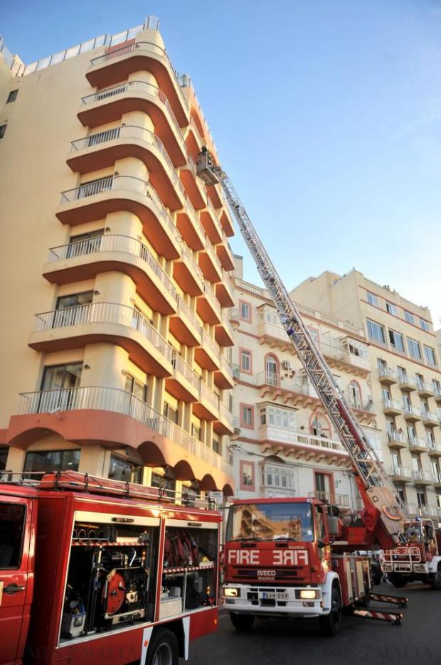 Firefighters provide assistance after an elevator at the Plaza Hotel in Sliema caught fire, leaving three persons in need of hospitalisation on May 6. Photo: Steve Zammit Lupi