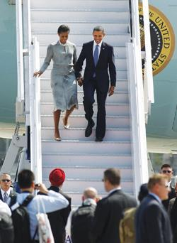 US President Barack Obama and First Lady Michelle Obama walk down the steps of Air Force One as they arrive in Mumbai, India, yesterday.