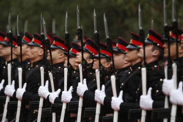 Armed Forces of Malta soldiers prepare for the arrival of Britain's Queen Elizabeth for the Commonwealth Heads of Government Meeting (CHOGM) at San Anton Palace in Attard on November 26. Photo: Darrin Zammit Lupi