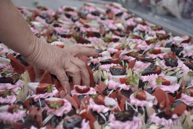 A woman picks out a chocolate strawberry muffin at the Strawberry Feast in Mgarr on April 10. Photo: Mark Zammit Cordina