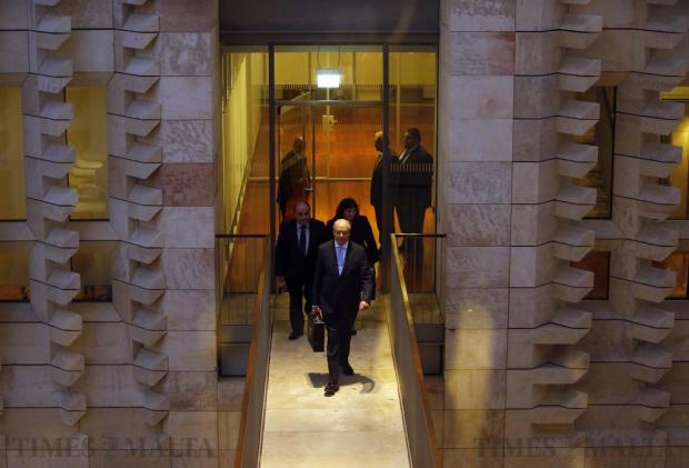 Finance Minister Edward Scicluna crosses to the parliamentary chambers to deliver the 2017 Budget speech at Parliament House in Valletta on October 17. Photo: Darrin Zammit Lupi