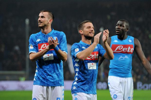 Napoli's Dries Mertens, Fabian Ruiz and Kalidou Koulibaly celebrate after the match.