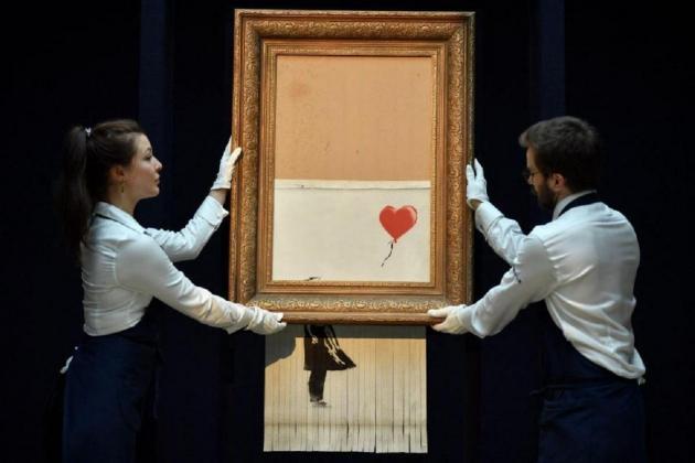 Shredded Banksy canvas sells for record €22 million