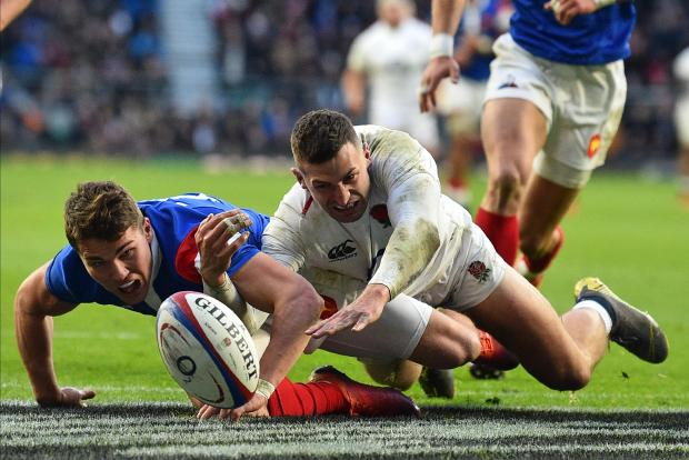 France's Antoine Dupont (L) and England's Jonny May try to reach the ball over the try line in their Rugby Six Nations fixture.