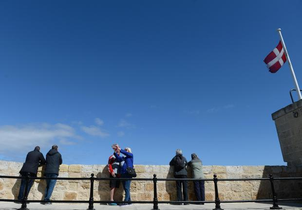 A group of tourists take photos from the bastions in Mdina on March 5. Photo: Matthew Mirabelli