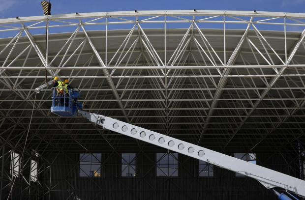 Workers carry out construction works on one of the new hangars being built at the Aviation Park in Safi on April 20. Photo: Darrin Zammit Lupi