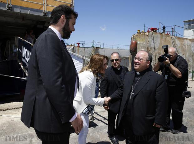 Migrant Offshore Aid Station (MOAS) founders Chris and Regina Catrambone welcome Archbishop Charles Scicluna to the rescue ship MV Phoenix at Bezzina Shipyards in Marsa on May 21. Photo: Darrin Zammit Lupi